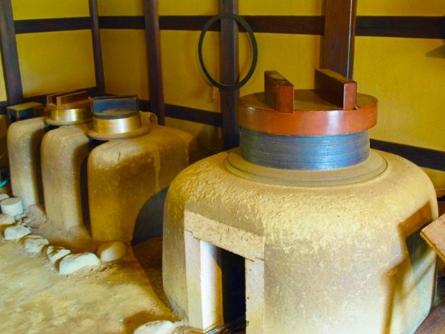 picture: an old style Japanese kitchen called kamado